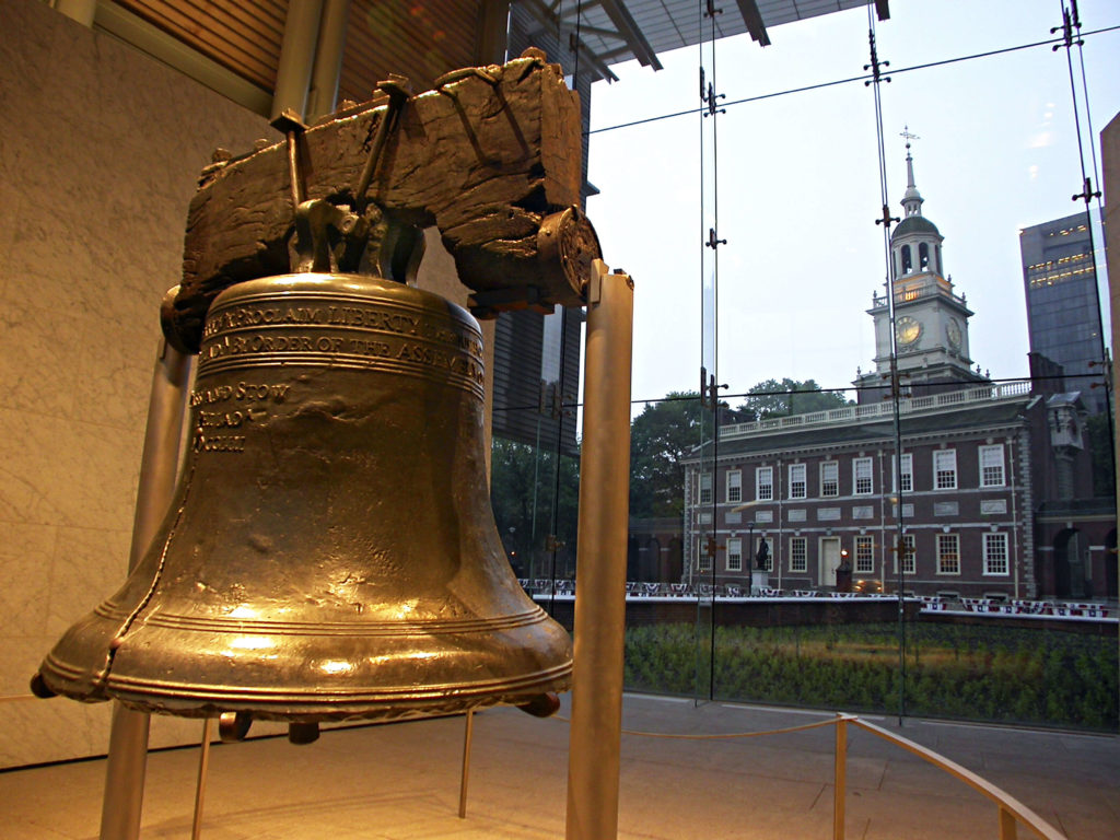 close up of the Liberty Bell and Independence Hall